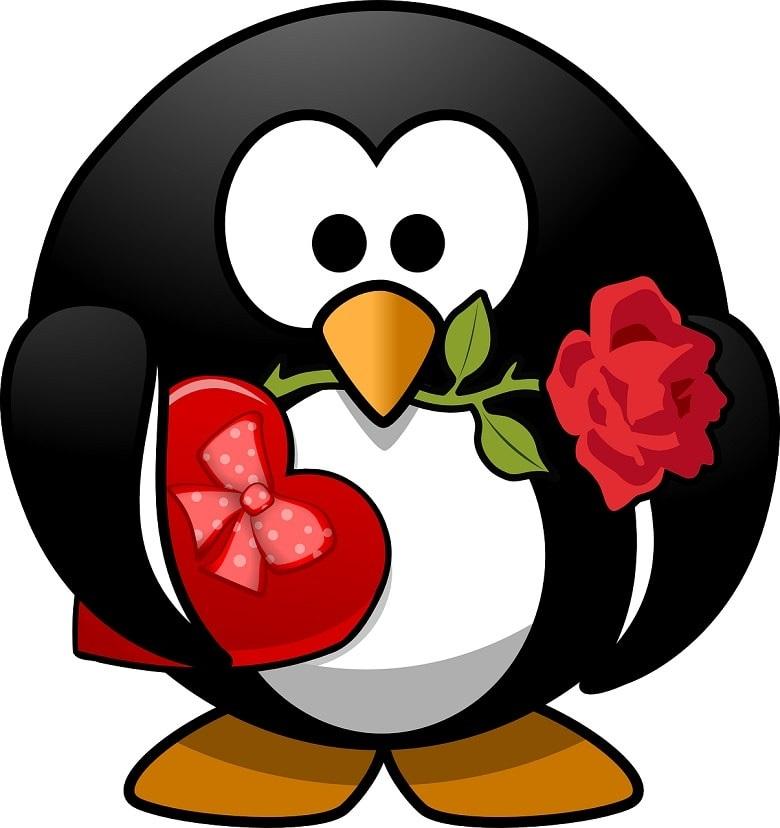 Ein Zeichentrick-Pinguin mit einer Rose im Schnabel und einer Packung Pralinen in Herzform unter dem Flügel. Symbolbild für Gedanken über die große Liebe.